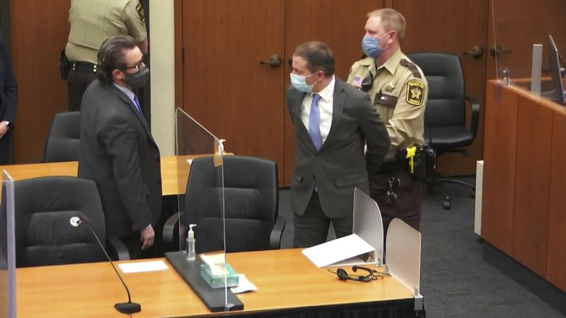 In this image from video, former Minneapolis police Officer Derek Chauvin, center, is taken...