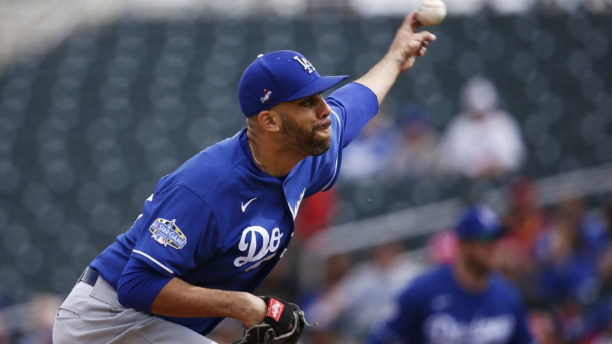 FILE - In this March 2, 2020, file photo, Los Angeles Dodgers starting pitcher David Price throws against the Cincinnati Reds during the first inning of a spring training baseball game in Goodyear, Ariz. Price will not play this season because of concerns over the coronavirus pandemic, delaying his Los Angeles debut until next year. The five-time All-Star became the latest player to opt out, posting Saturday, July 4, 2020, on Twitter that he would not participate in the 60-game season that is scheduled to begin July 23.