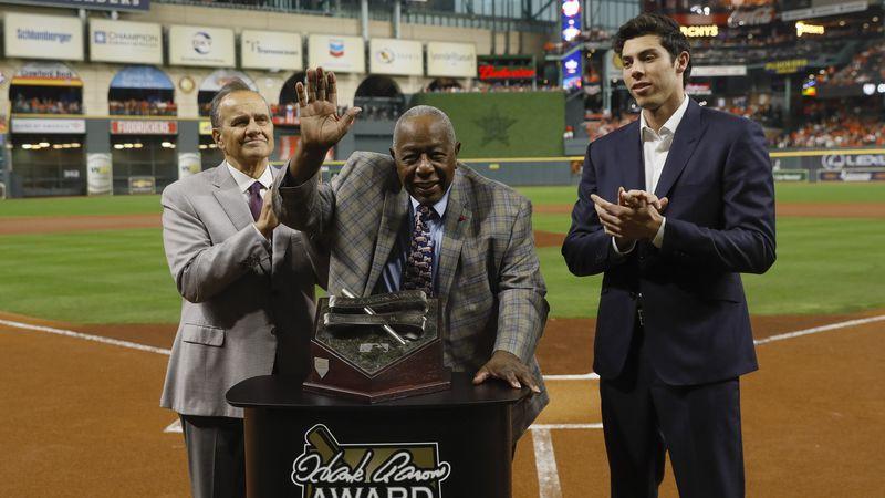 Hank Aaron is flanked by Joe Torre, left, and Milwaukee Brewers Christian Yellich before Game 2...