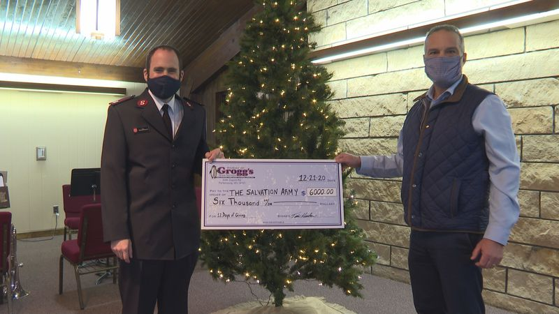 Grogg's provides monetary help to Salvation Army's red kettle campaign