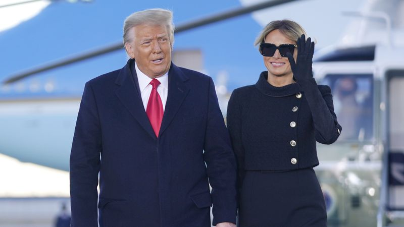 President Donald Trump and first lady Melania Trump arrive on Marine One before boarding Air...