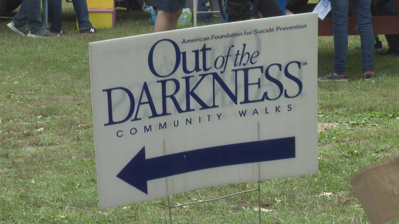 People gather together in City Park for the MOV Out of the Darkness Walk