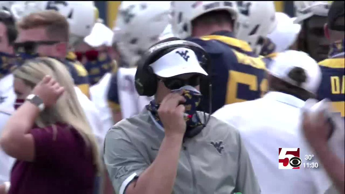 West Virginia University signs football coach Neal Brown to a 2 year contract extension.