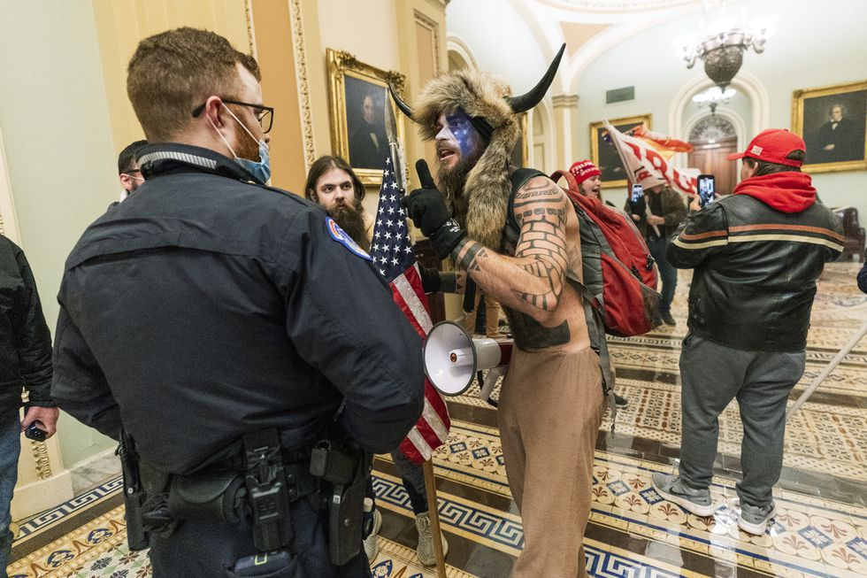 FILE - In this Jan. 6, 2021, file photo supporters of President Donald Trump are confronted by...