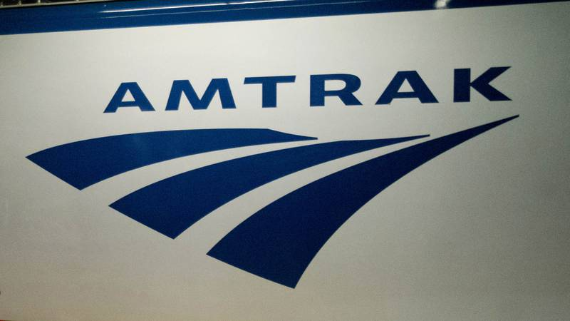 FILE - In this Feb. 6, 2014 file photo, an Amtrak logo is seen on a train at 30th Street...