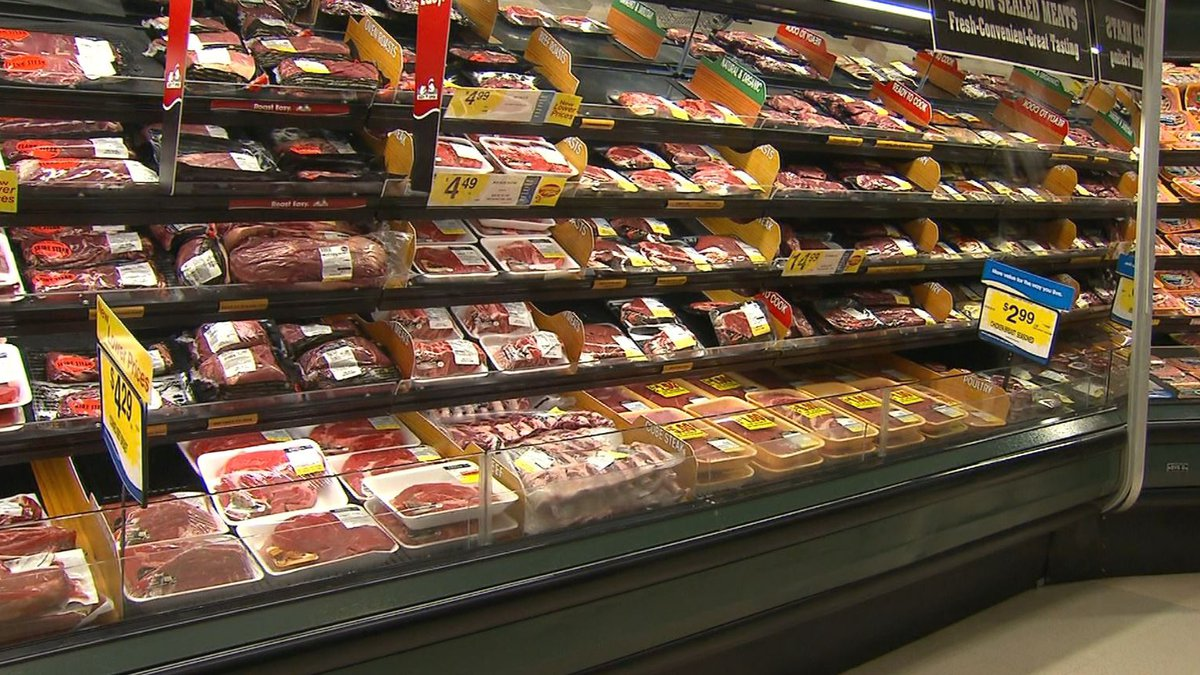 FILE – This image shows meat on shelves in a grocery store. Wholesale prices, driven by rising...