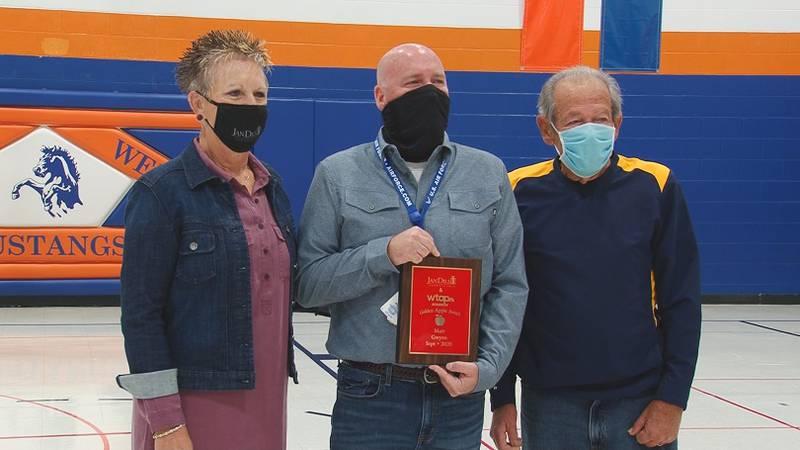 Matt Gwynn (center) is the September 2020 recipient of the Jan Dils Golden Apple award
