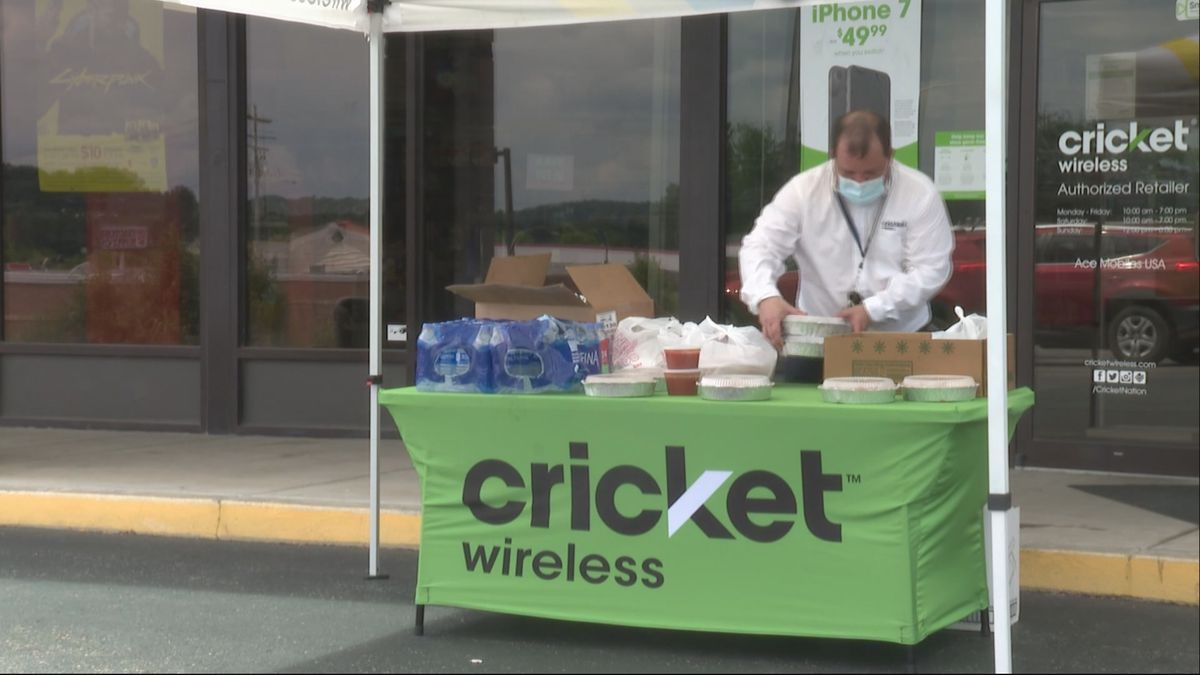 Employees at Cricket Wireless hand out free food.