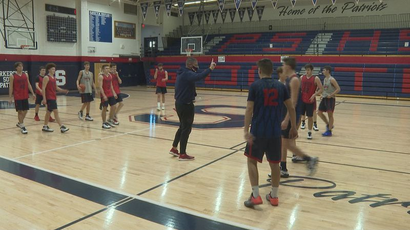 Coach Mike Fallon (center) will be leading the Patriots after a year off