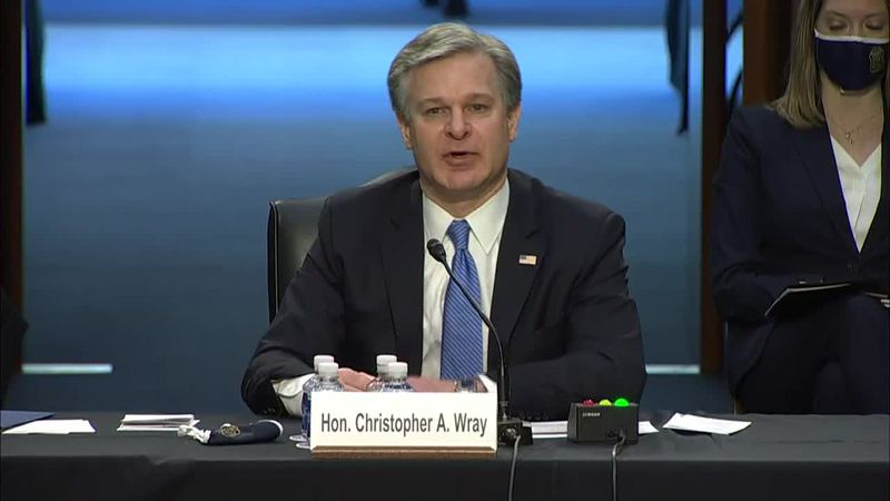 FBI director Christopher Wray faced questioning from senators on Tuesday over the Capitol...