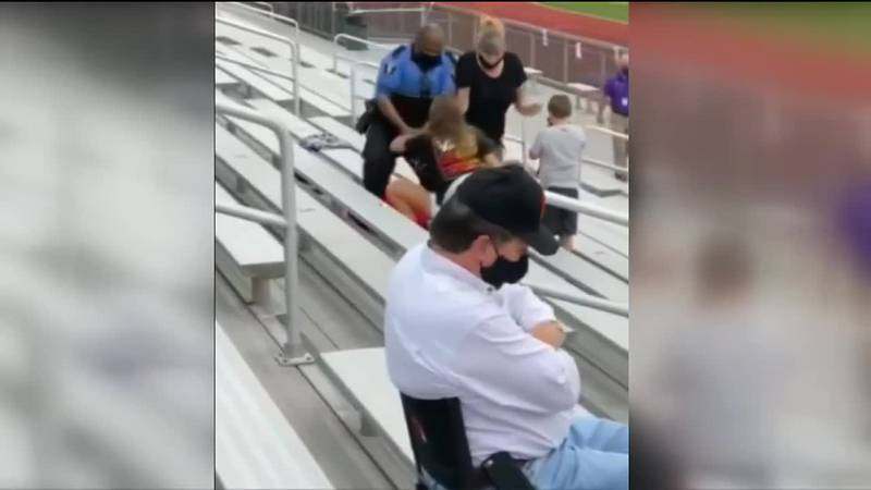 The woman allegedly was not complying with mask ordinances at the game in Logan, Ohio.