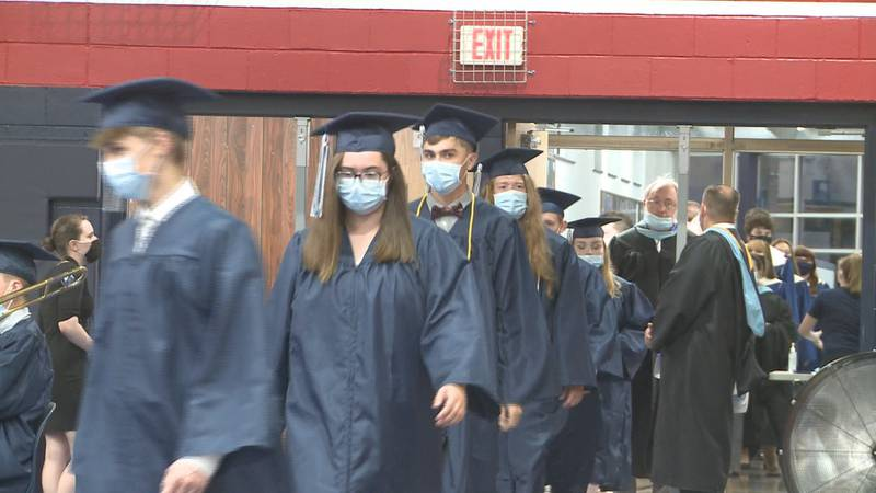 Around 300 graduates crossed the stage Friday night after a challenging school year for all.