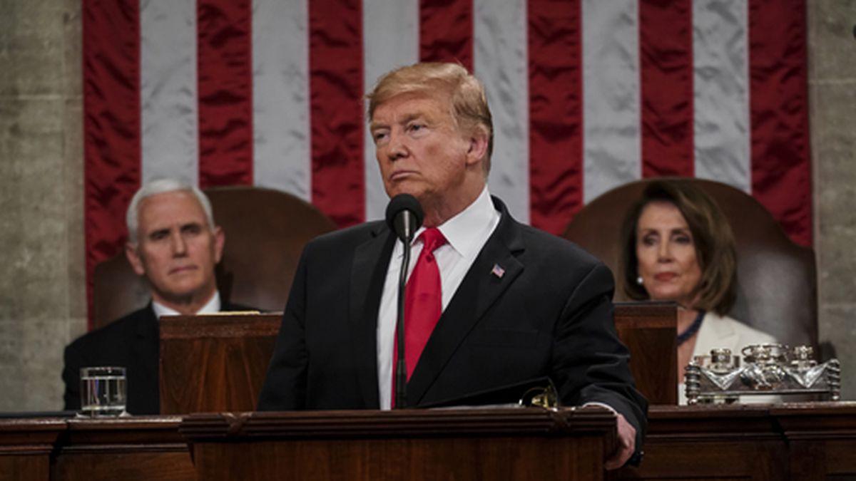 President Donald Trump gives his State of the Union address to a joint session of Congress, Tuesday, Feb. 5, 2019, at the Capitol in Washington, as Vice President Mike Pence, left, and House Speaker Nancy Pelosi look on. (Doug Mills/The New York Times via AP, Pool)