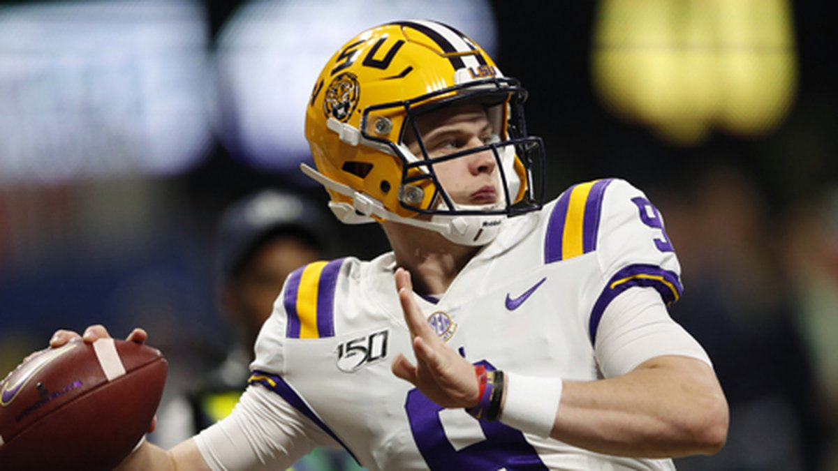 In this Dec. 7, 2019, file photo, LSU quarterback Joe Burrow (9) warms up before the...