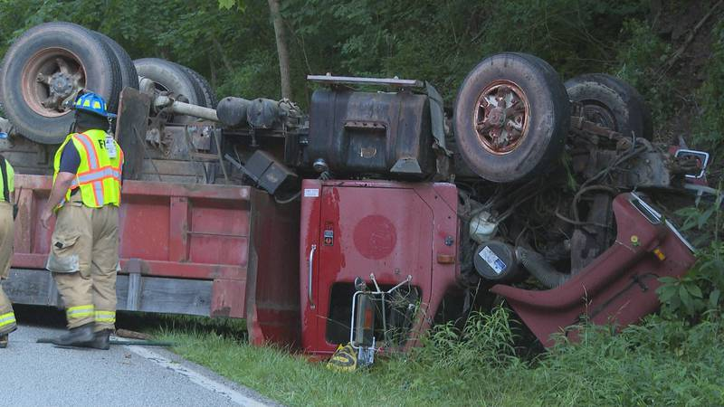 Dump truck flips over, driver taken to hospital with serious injuries