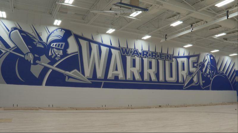 Mural being painted at new Warren High School.