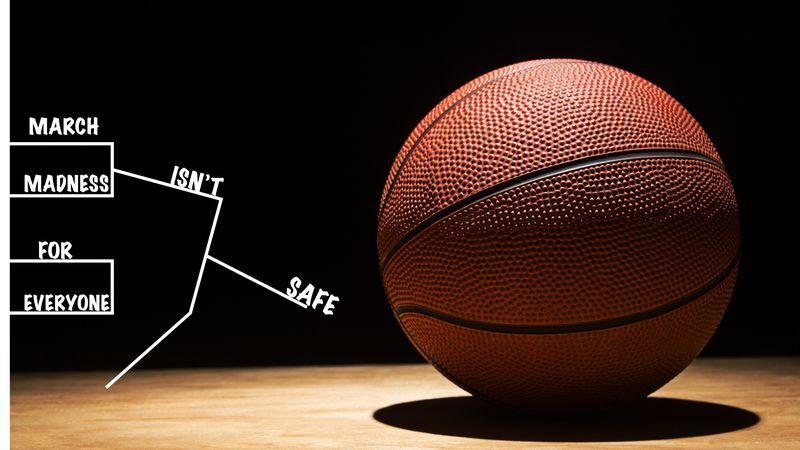 basketball on the hardwood in a spotlight