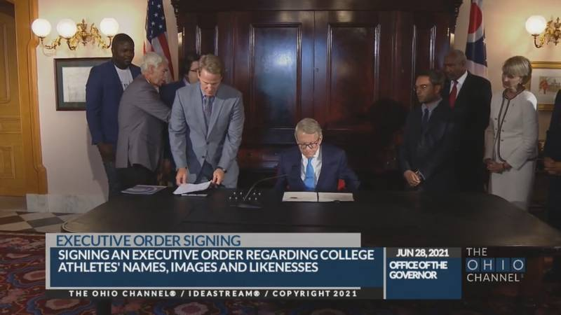 Gov. Mike Dewine signs executive order allowing college athletes to earn money off of name,...