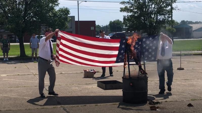 American Legion Post 15 members conduct flag burning ceremony