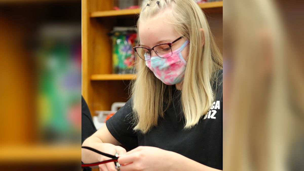 Blennerhassett Middle School student Sydney McKee works on assembling keychains in the schools'...
