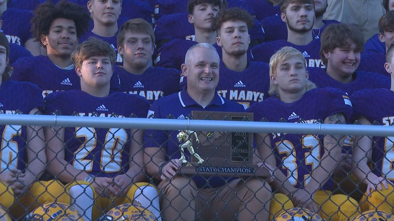 Coach Jodi Mote (center) and the rest of the Blue Devils receive their Class A trophy