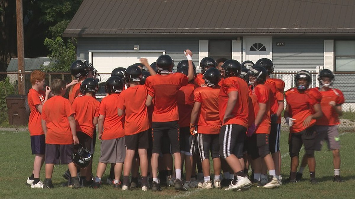 Belpre gathers around Coach Bell before the start of practice