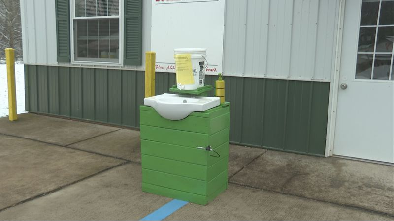 Girl scouts make touchless hand washing station for Broughton's Nature Preserve.
