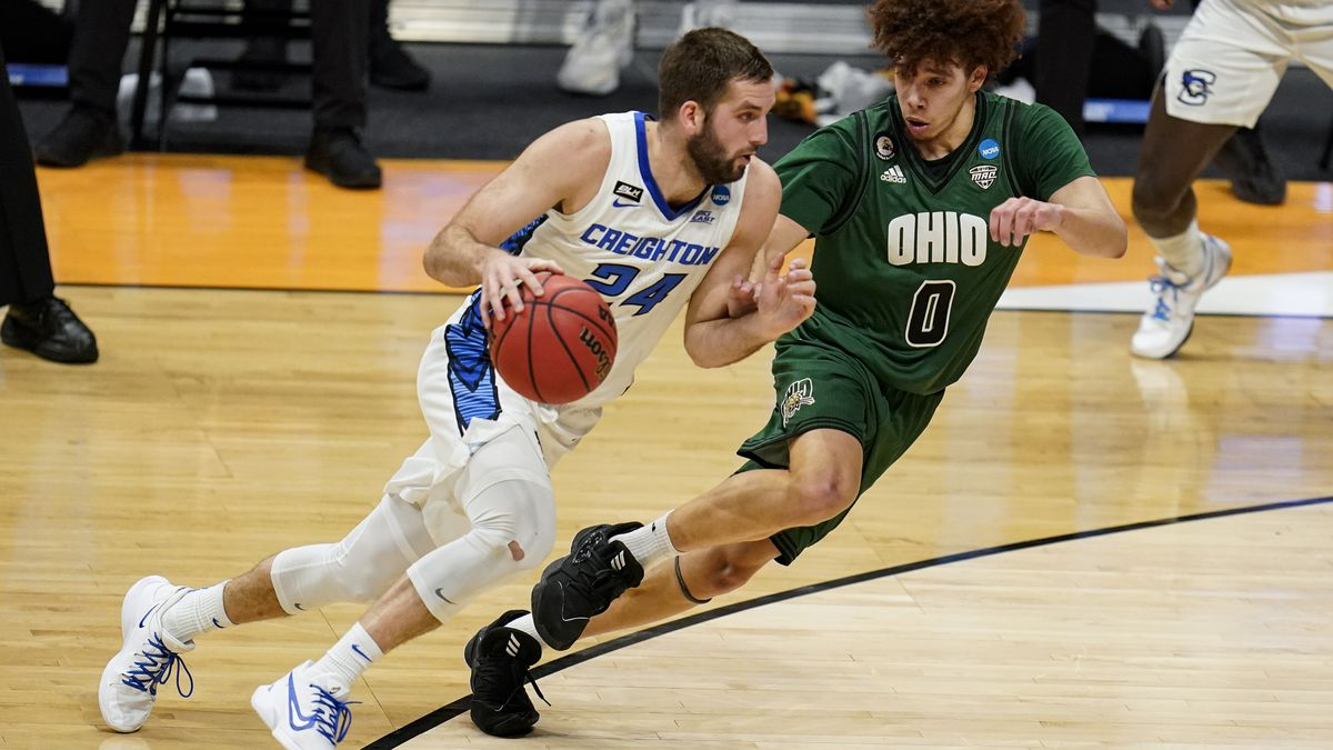 Creighton guard Mitch Ballock (24) drives on Ohio guard Jason Preston (0) in the first half of...