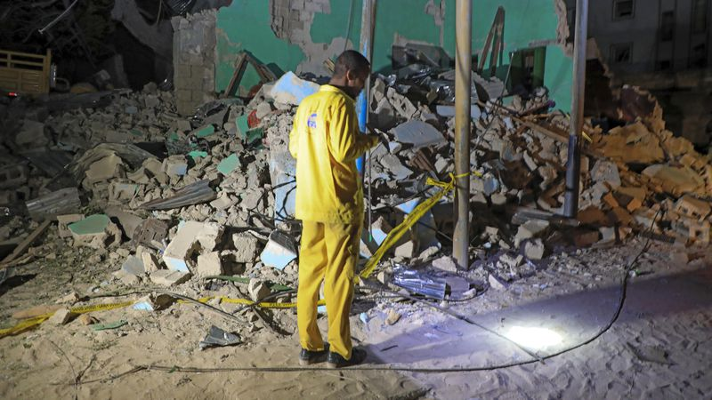 A man observes a destroyed building at the scene of a blast at a popular restaurant in the...