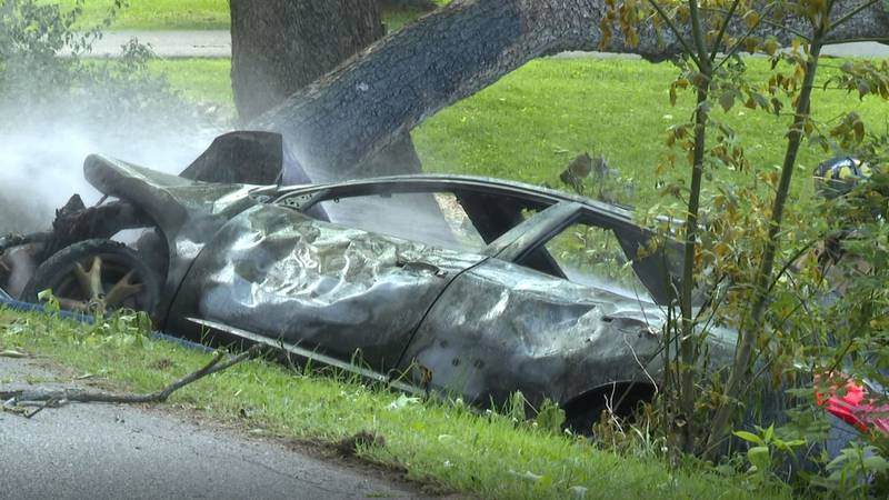 Car after becoming engulfed in flames following crash