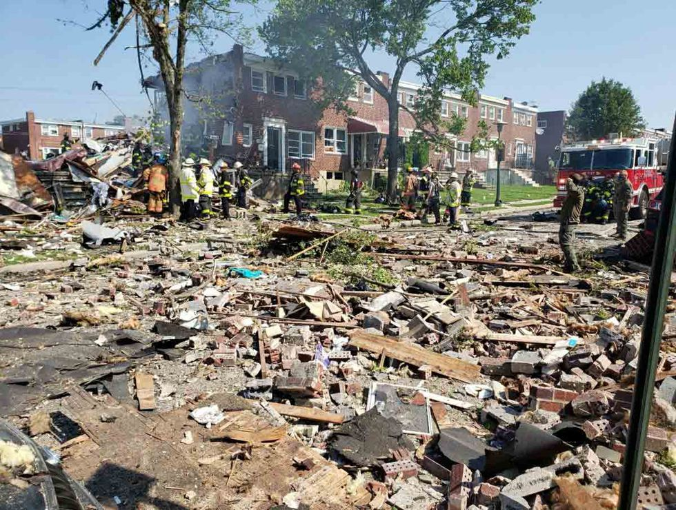 Debris is seen after a house explosion Monday in Baltimore.