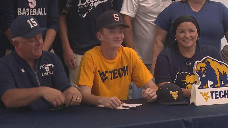 Ben McPeek (center) signs with West Virginia Tech