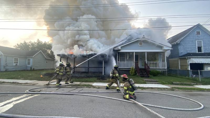 An unoccupied home caught fire Sunday morning and the fire traveled to the neighboring home,...