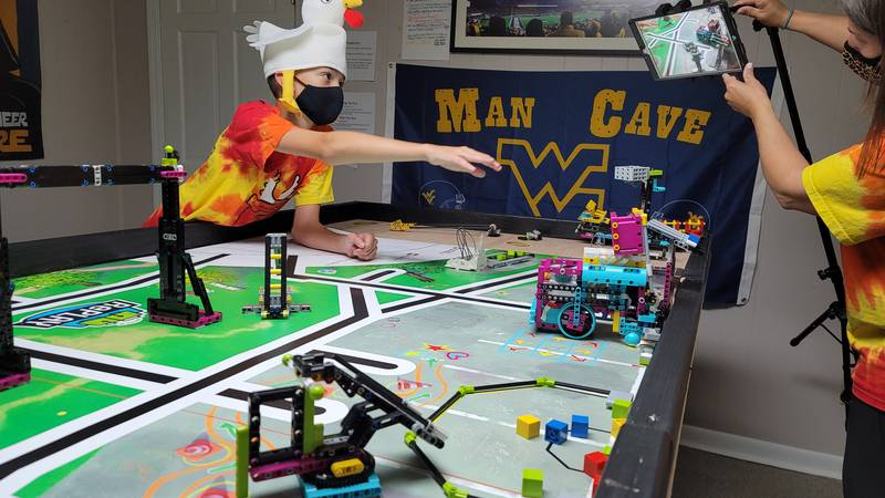 The Tender Defenders record a robot run for the FIRST Lego League Virtual Open Invitational.