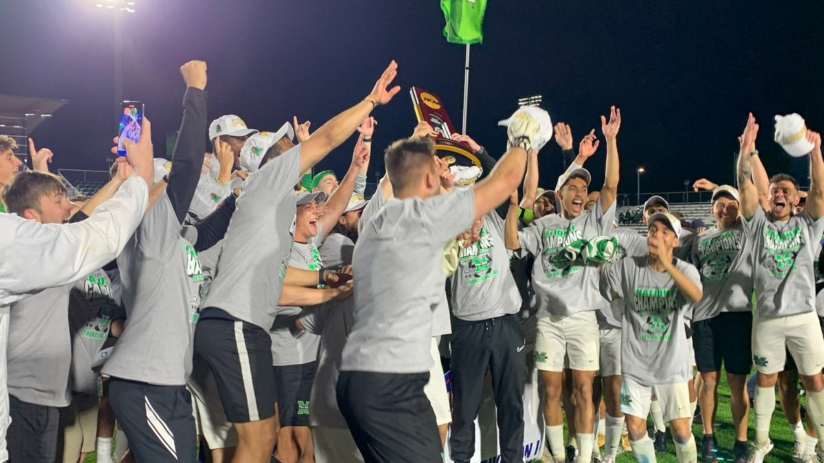 The Marshall Thundering Herd lift the NCAA title trophy after their overtime win over Indiana