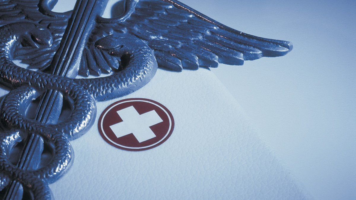 Caduceus with First-aid Kit --- Image by � Royalty-Free/Corbis