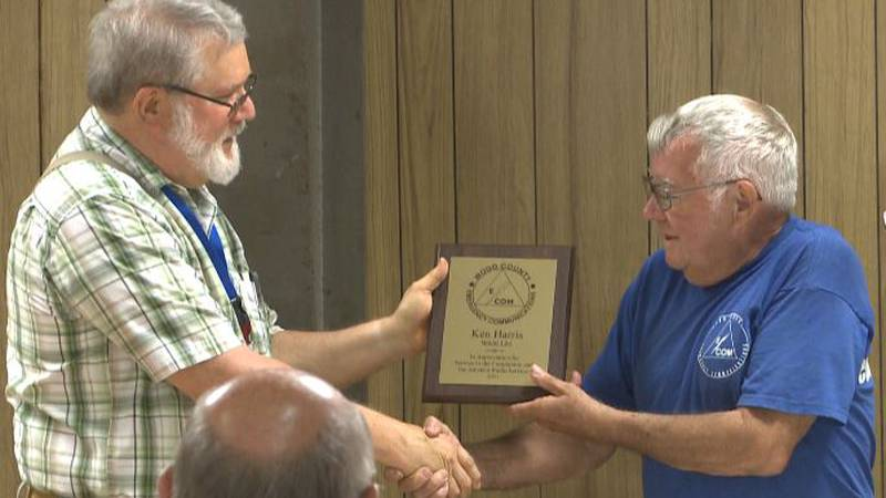 Kenny Harris is honored by WCEC for decades of service to the region.