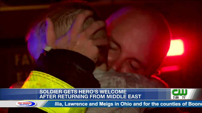 Captain David Cottrill surprised his two sons after returning home from the Middle East.