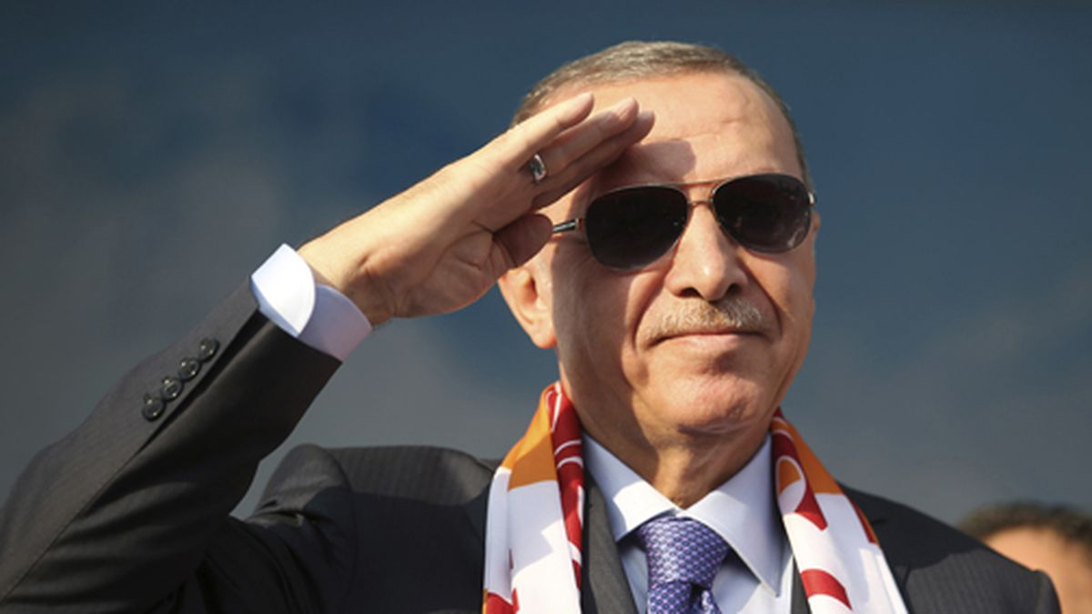 Turkish President Recep Tayyip Erdogan gives a military-style salute toward his supporters during a rally in Kayseri, Turkey, Saturday, Oct. 19, 2019. (Presidential Press Service via AP, Pool)