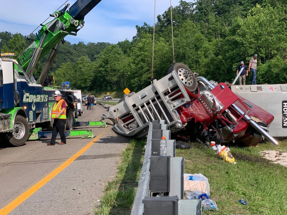 A rollover crash involving a tractor-trailer hauling cows shut down I-64 in West Huntington.