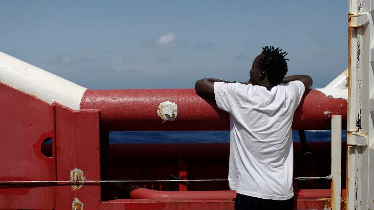 A man looks at the horizon from the Ocean Viking in Mediterranean Sea, Tuesday, Sept. 10, 2019....