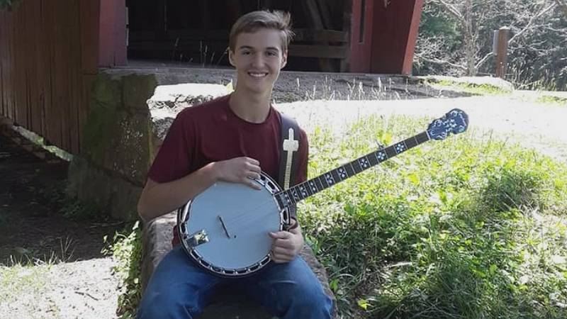 Jordan Tolley loves playing his banjo