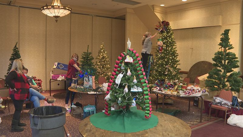 """Trees are being decorated for the annual """"Festival of Trees."""""""