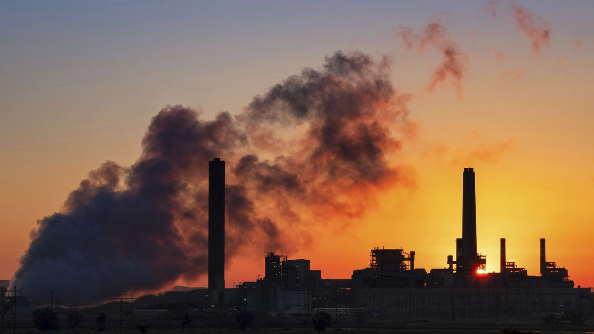 FILE - In this July 27, 2018 file photo, the Dave Johnson coal-fired power plant is silhouetted...