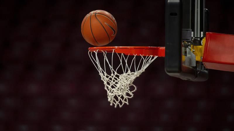 A basketball nears the rim