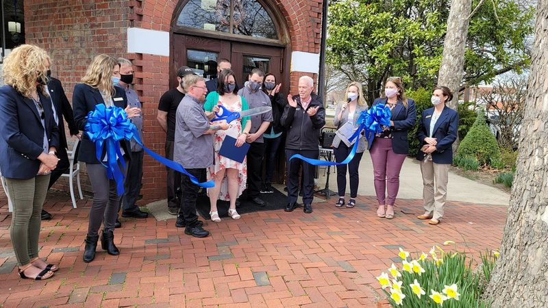 Owner and chef Tom Hickey cuts the ribbon during Tuesday's ceremony.