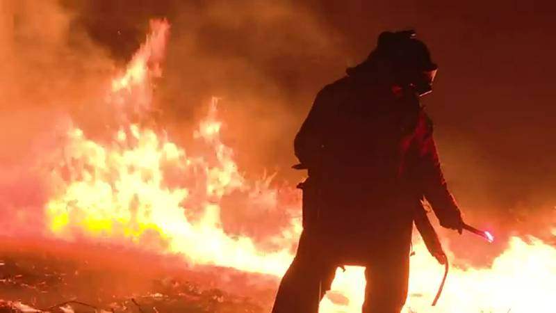 Nearly 22,000 firefighters and support personnel were battling 91 large, active wildfires...