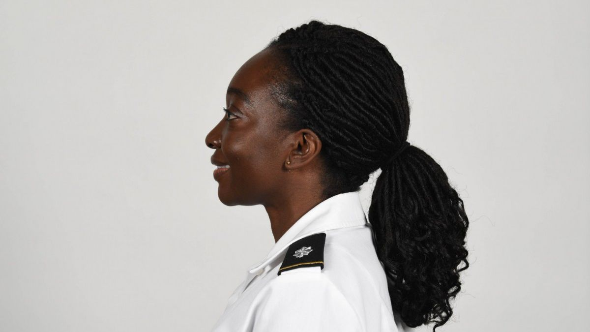 Under the updated policy, female soldiers may wear braids and ponytails down the center of...