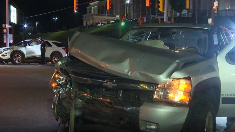 The truck (foreground) and SUV involved in Monday night's crash